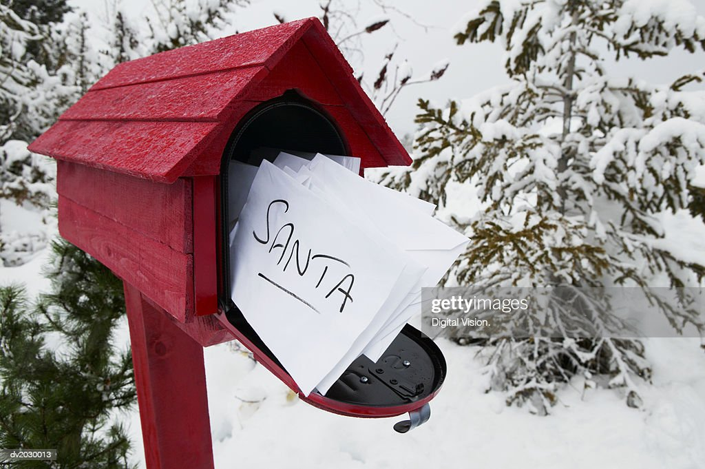 Red Post Box Containing Letters to Santa : Stock Photo
