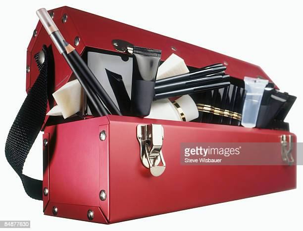 Red professional toolbox style case full of makeup