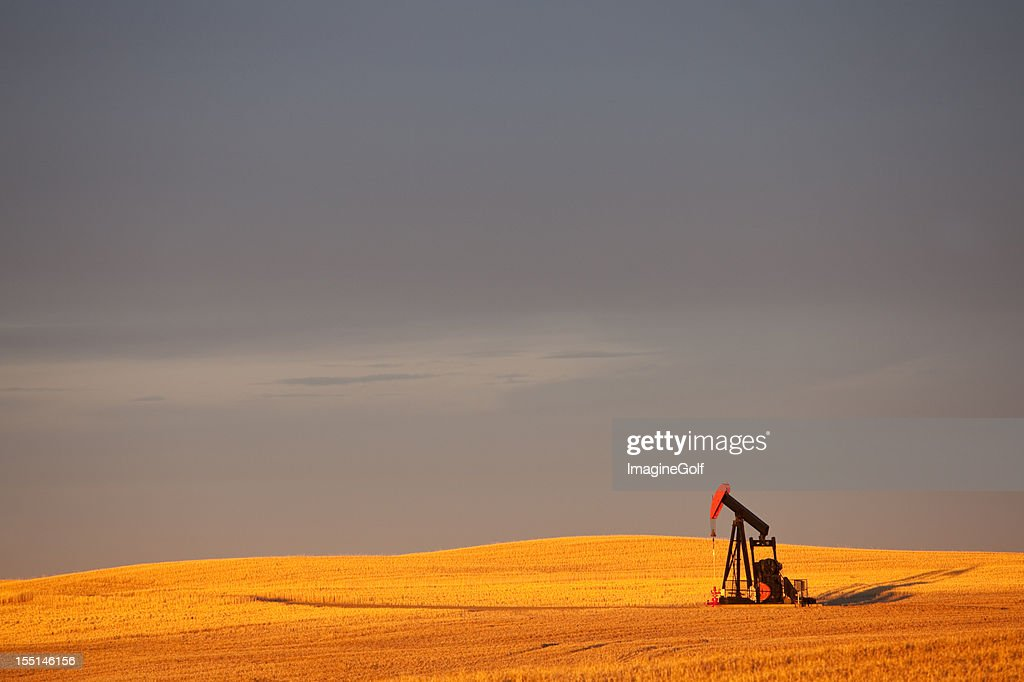 Red Pumpjack in an Oil Field In Alberta Canada : Stock Photo