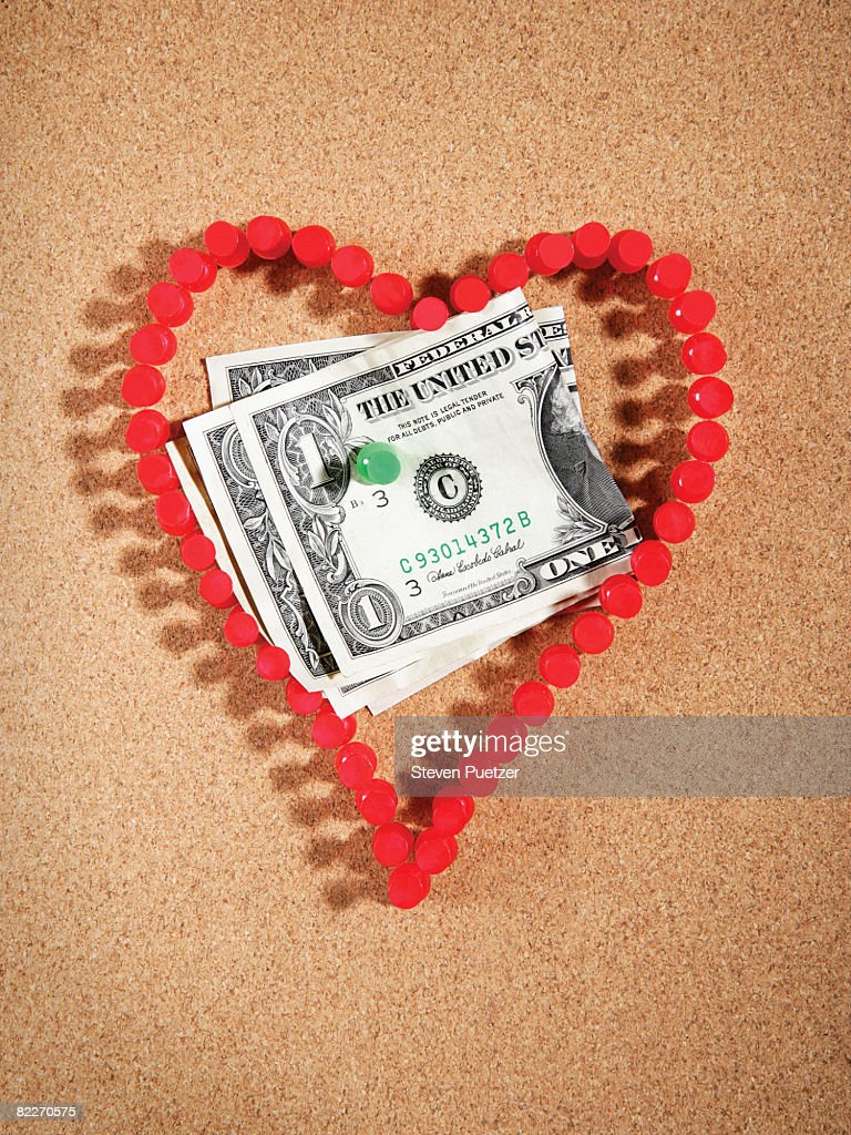 Red push pins on board in the shape of a heart  : Stock Photo
