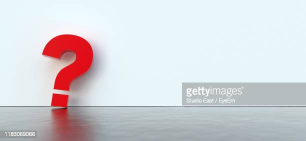 red question mark sign against wall - 疑問符 ストックフォトと画像