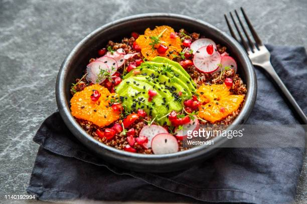 red quinoa salad with avocado, tomatoes, red radishes, pomegranate seeds, black sesame and cress - antioxidant stock pictures, royalty-free photos & images