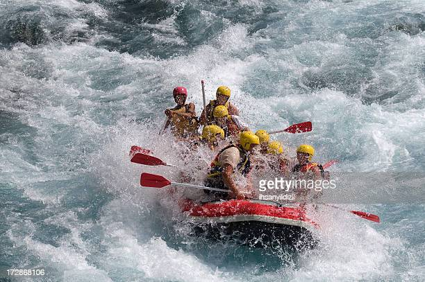 Red raft in violent white water