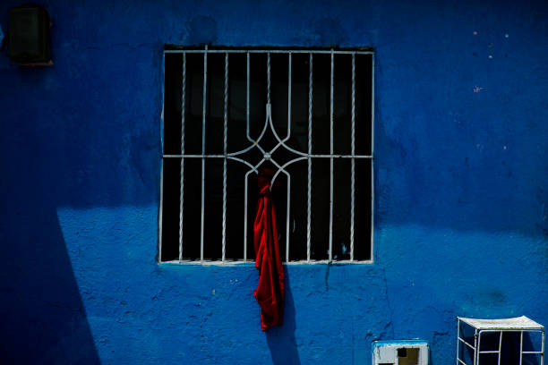 Red rag on windows to protest amid quarantine Colombia