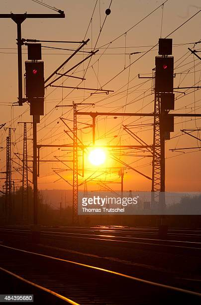 Red railway signals on a electrified railway during sunset on October 31 2010 in Neudietendorf Germany