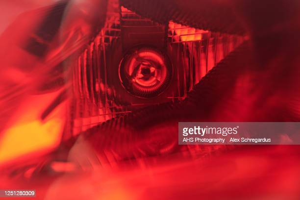 red rear car light close-up - glass material stock pictures, royalty-free photos & images