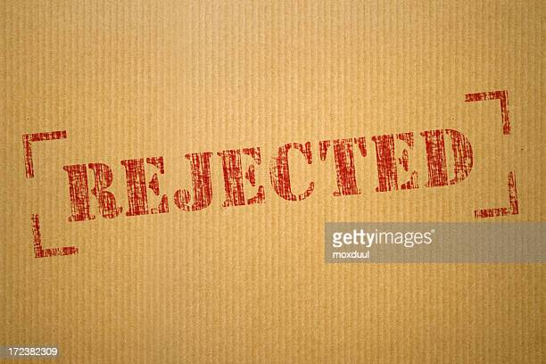 red rejected stamp on cream envelope - dismissal stock photos and pictures