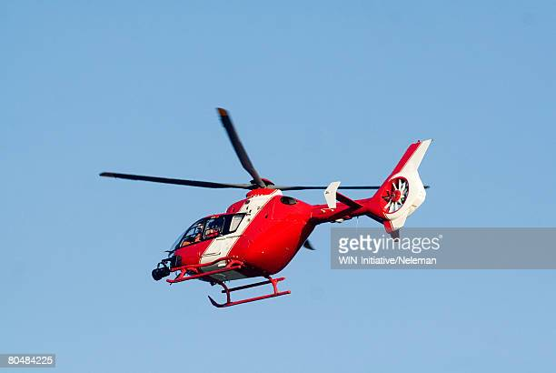 Red rescue helicopter, low angle view