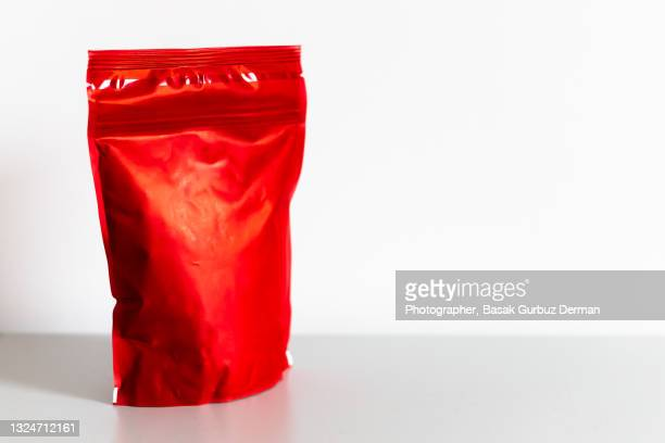 a red re-sealable zipper bag - sachet stock pictures, royalty-free photos & images