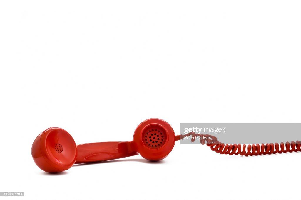 Red retro telephone receiver : Stock Photo