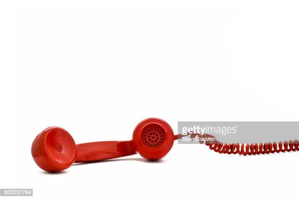 red retro telephone receiver - the past stock pictures, royalty-free photos & images