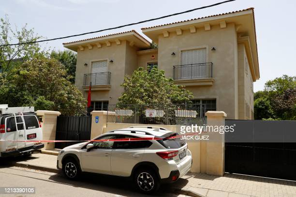 Red ribbon blocks the entrance to the residence of Israel's Chinese ambassador on the outskirts of Tel Aviv, after he was found dead on May 17, 2020....