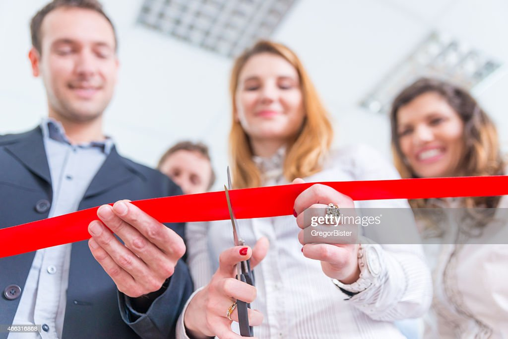 Red ribbon cutting ceremony from low angle : Stock Photo
