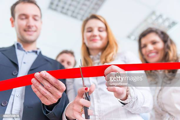 red ribbon cutting ceremony from low angle - opening ceremony stock pictures, royalty-free photos & images