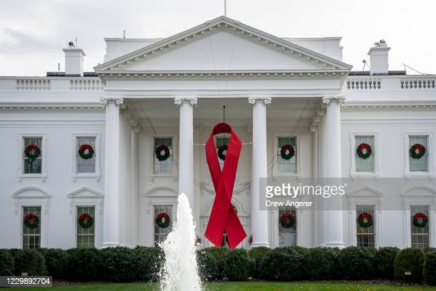 Red ribbon is displayed on the North Portico of the White House to recognize World AIDS Day on December 1, 2020 in Washington, DC. Tuesday, December...