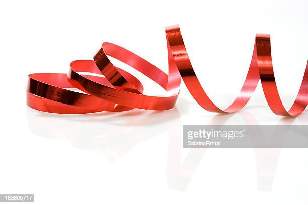 red ribbon on white - streamer stock photos and pictures