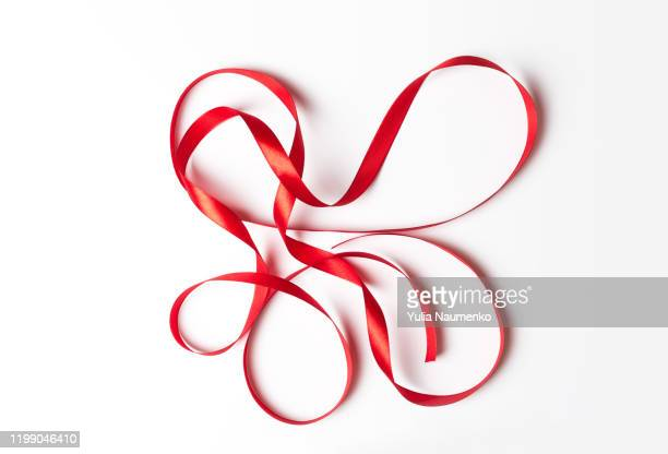 red ribbon smoked curl isolated on white background. ribbon pattern. - silk stock pictures, royalty-free photos & images