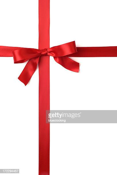 a red ribbon tied in a bow across the page - tied bow stock pictures, royalty-free photos & images