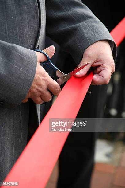 red ribbon vertical - ribbon cutting stock pictures, royalty-free photos & images