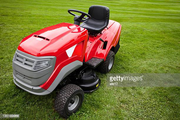 Red riding mower parked on the grass