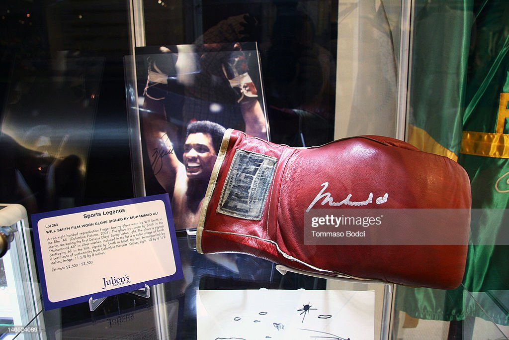 A red right handed reproduction Frager boxing glove worn by Will Smith in the film Ali is displayed at the Julien's Auctions press call for Music Icons And Sports Legends Memorabilia Auction held at Julien's Auctions Gallery on June 18, 2012 in Beverly Hills, California.
