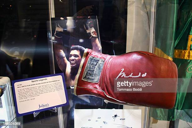 A red right handed reproduction Frager boxing glove worn by Will Smith in the film Ali is displayed at the Julien's Auctions press call for Music...