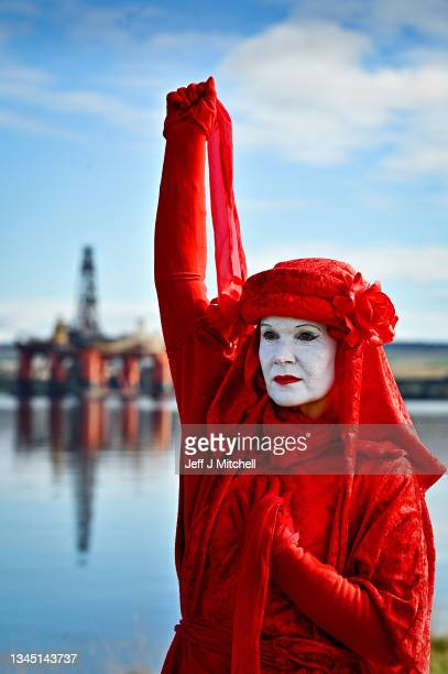 Red robed protesters from Extinction Rebellion take part in blockading the oil rig maintenance facility at Cromarty Firth Port Authority on October...