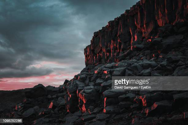 red rock formation on mountain against sky - lava stock pictures, royalty-free photos & images