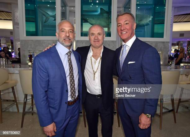 Red Rock Resorts CoFounder Lorenzo Fertitta artist Damien Hirst and Red Rock Resorts CoFounder Frank Fertitta attend the From Dust To Gold preview...
