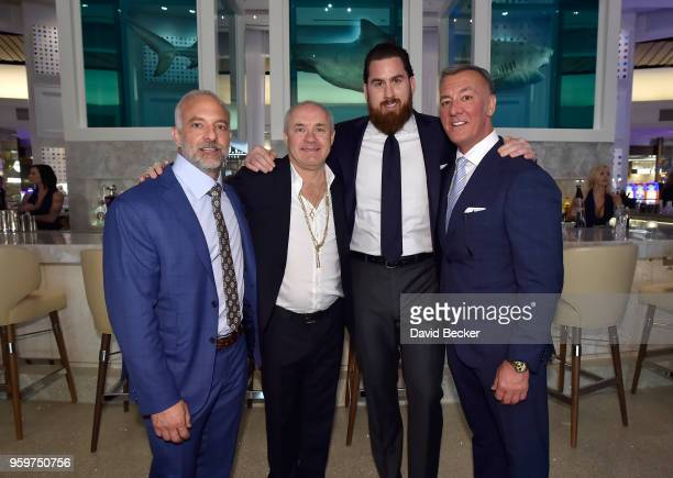 Red Rock Resorts CoFounder Lorenzo Fertitta artist Damien Hirst Fertitta Capital Vice President Pat Lewis and Red Rock Resorts CoFounder Frank...