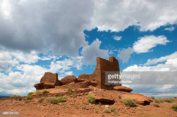 Red rocks in the foreground of the remains of the Wukoki Pueblo in the Wupatki National Monument Park in northern Arizona, USA, where the Northern...