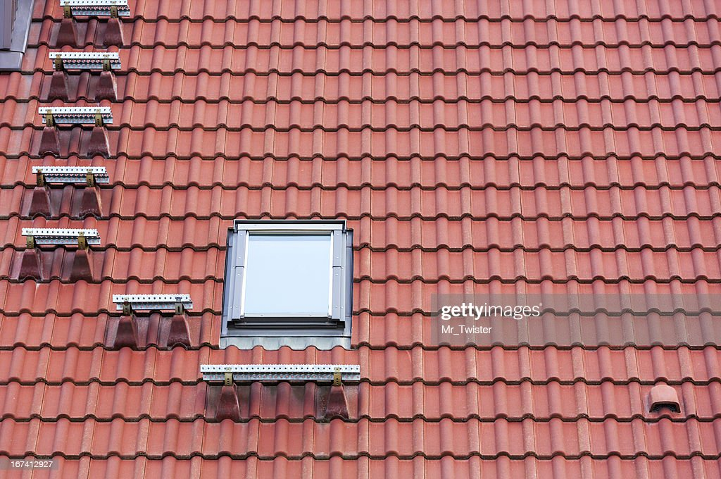 Red roof and window : Stock Photo