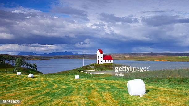 Red roof chapel in Ulfljotsvat in Thingvellir National Park rural landscape in Iceland 2011