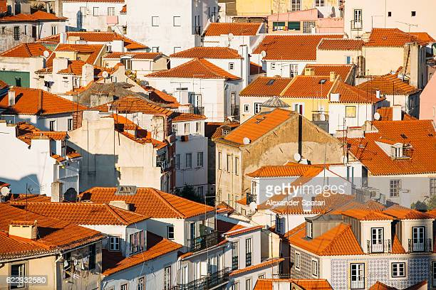 red rooftops of alfama district, lisbon, portugal - alfama stock photos and pictures