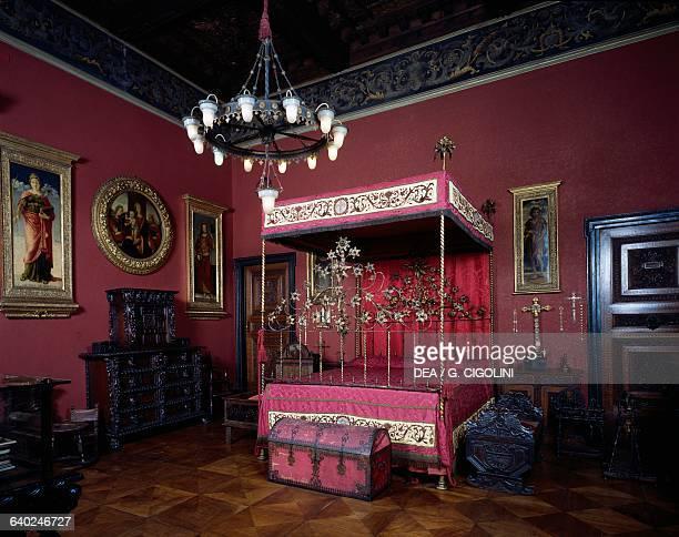 Red room Carolina Borromeo and Giuseppe Bagatti Valsecchi's bedroom with Sicilian wrought iron bed decorated with gold leaf Bagatti Valsecchi museum...