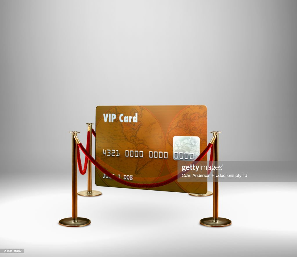 Red rope barrier around VIP credit card : Stock Photo