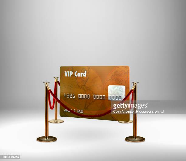 red rope barrier around vip credit card - cordon boundary stock pictures, royalty-free photos & images