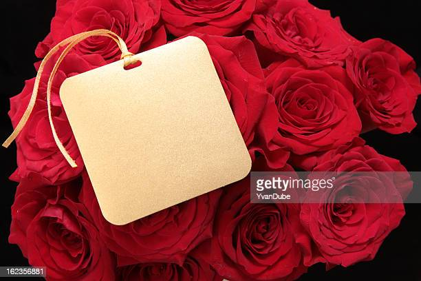 red rose bouqet with greeting card