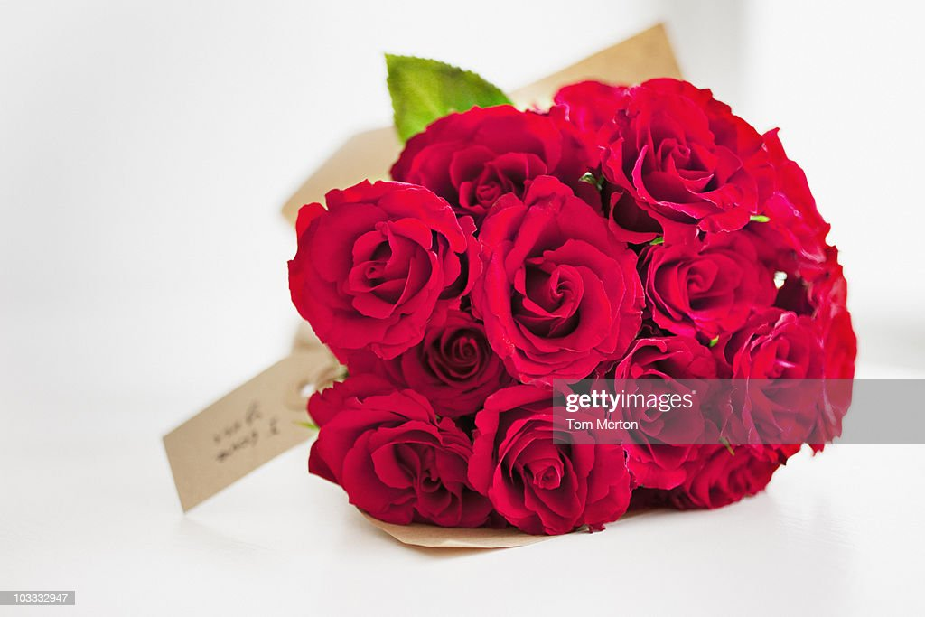 Red rose bouquet with gift tag : Stock Photo