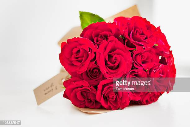 Red rose bouquet with gift tag