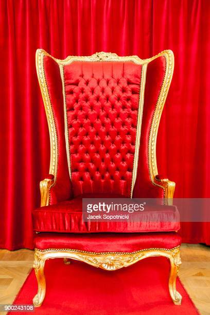 red royal throne and red curtain behind - throne stock pictures, royalty-free photos & images