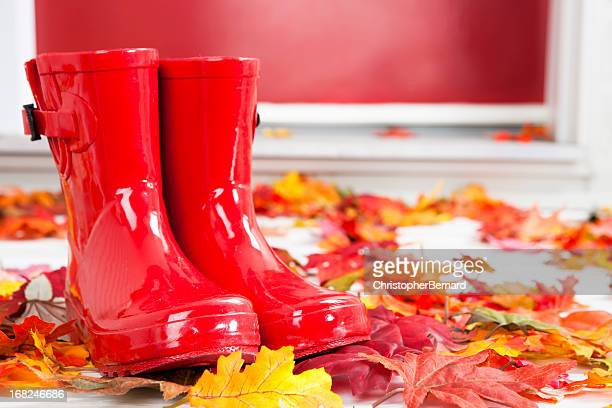 red rubber boots at front door - rubber boot stock pictures, royalty-free photos & images
