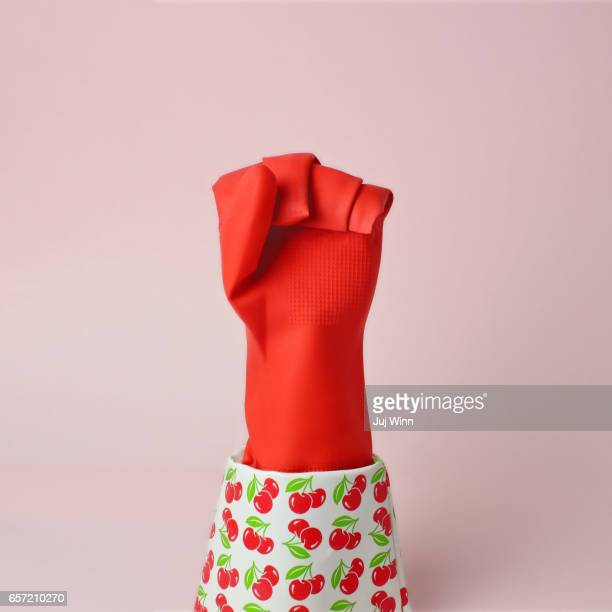 Red rubber glove in shape of protest fist