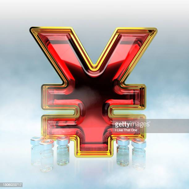 red ruby encrusted gold yen symbol surrounded by bottles of medicine and freezer fog - atomic imagery stock pictures, royalty-free photos & images