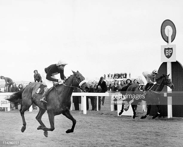 Red Rum ridden by Brian Fletcher beats Crisp to win the Grand National for the first time at Aintree in record time on 31st March 1973