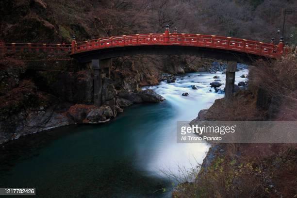 red sacred shinkyo bridge in autumn, nikko, japan - nikko city stock pictures, royalty-free photos & images