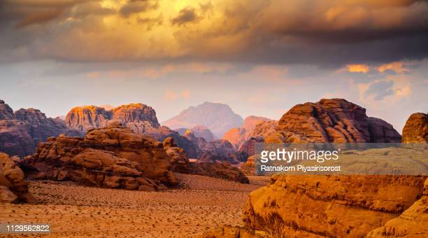 red sand dune and amazing rock in wadi rum desert, jordan - jordan middle east stock pictures, royalty-free photos & images