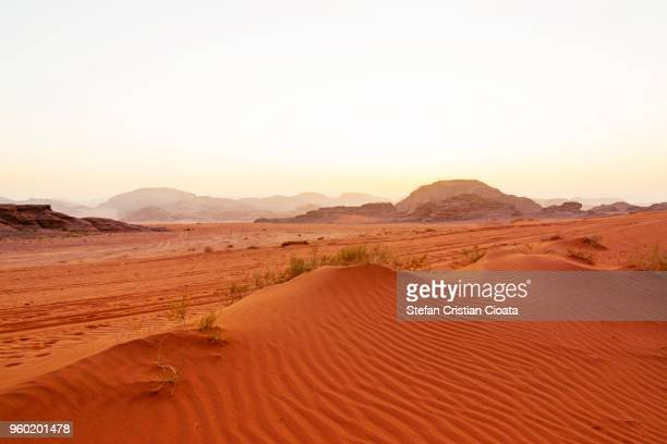 red sand in wadi rum desert jordan - mars stock pictures, royalty-free photos & images