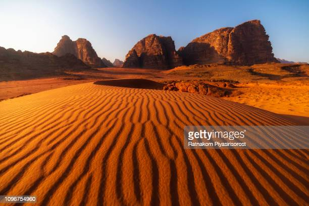 red sand of wadi rum desert, jordan - jordan middle east stock pictures, royalty-free photos & images