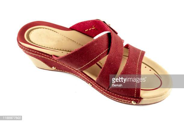 red sandals with a white background. - sandal stock pictures, royalty-free photos & images